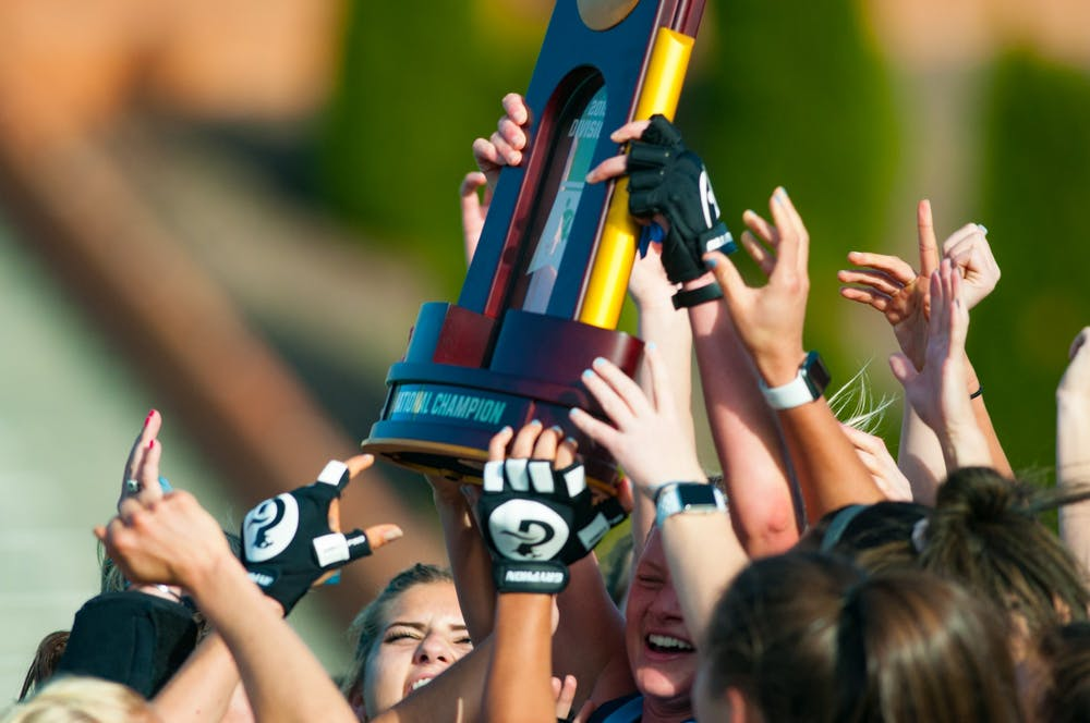 <p>UNC field hockey players raise their NCAA Division I Championships trophy in celebration after winning the game against Princeton University at Kentner Stadium on Sunday, Nov. 24, 2019. UNC won 6-1, marking their 8th national championship.</p>