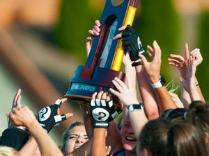 UNC field hockey players raise their NCAA Division I Championships trophy in celebration after winning the game against Princeton University at Kentner Stadium on Sunday, Nov. 24, 2019. UNC won 6-1, marking their 8th national championship.