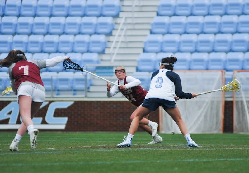 First-year midfielder Nicole Humphrey (9) shoots and scores a free position shot. The Tar Heels won 20-3 over Elon during the exhibition match on Feb. 1, 2020, at Dorrance Field.