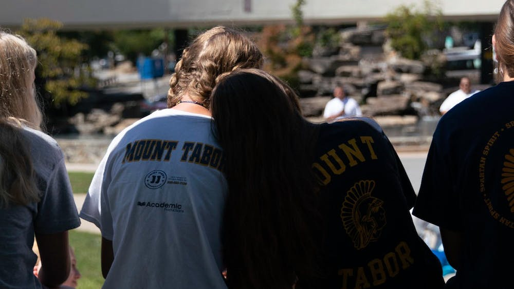 Two students rest their heads on each other at the Guns Down Lives Up rally in Winston-Salem on Sept. 4.