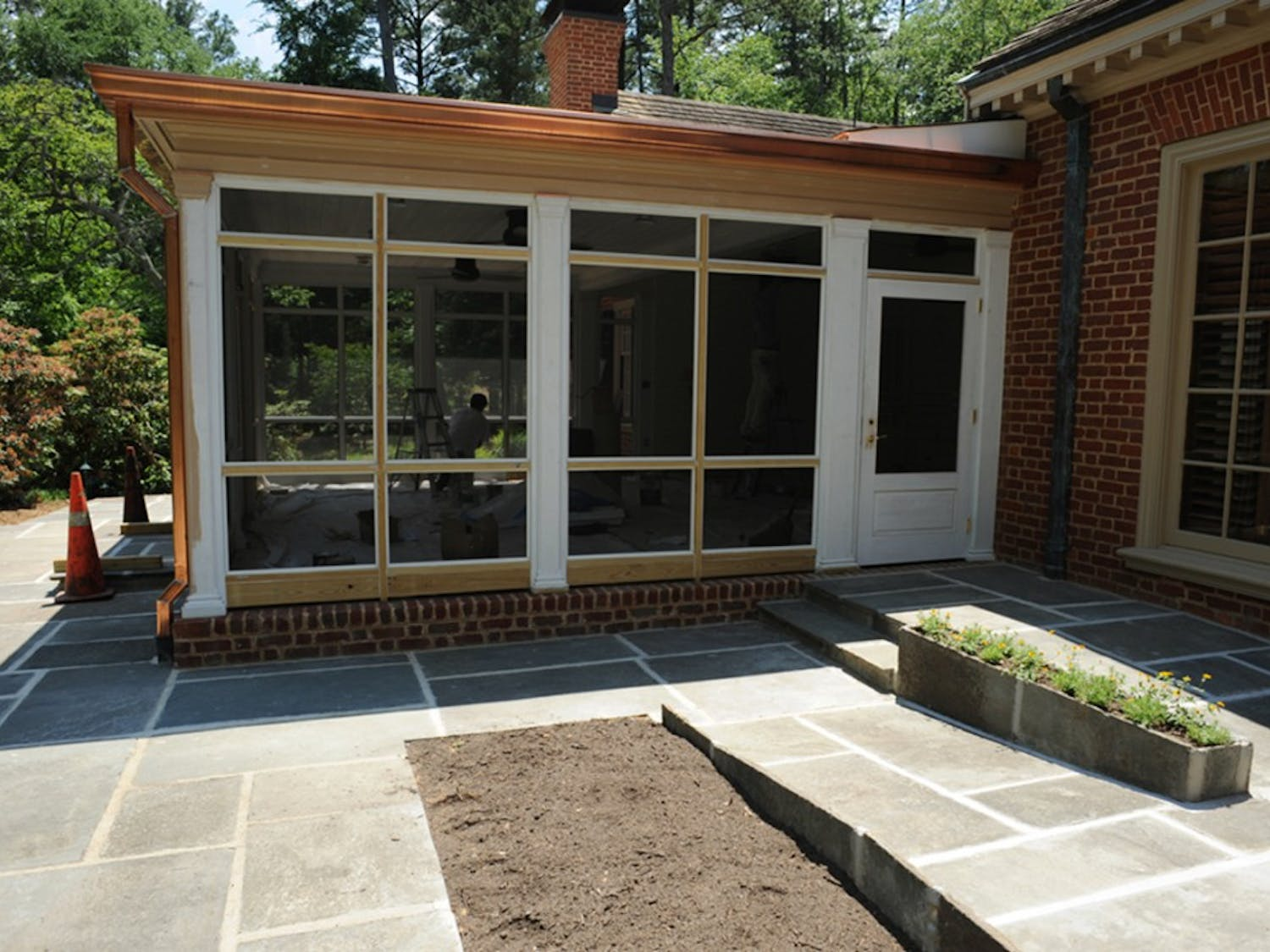 The porch at Chancellor Holden Thorp's house is being made compliant with the Americans with Disabilities Act with the addition of a ramp.