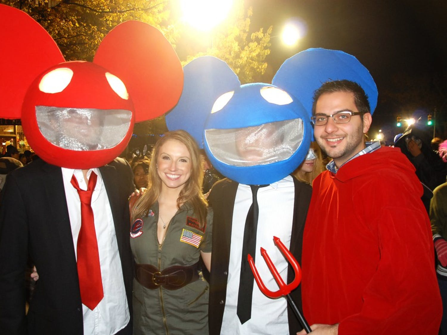 """Peter Ngeyen (far left) and Arend Klooster (second from right) pose as DeadMau5.""""Young kids think we are Mickey Mouse, but college kids know what we are,"""" Ngeyen said."""