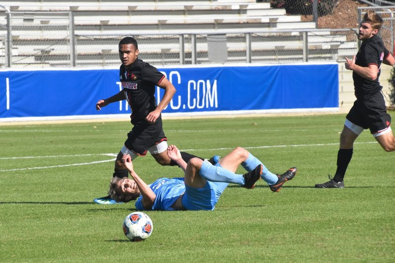 UNC freshman Milo Garvanian (32) is fouled by Louisville defender William Portman (14) in the ACC championship game on Sunday, Nov. 11, 2018 at WakeMed Soccer Park. UNC lost to Louisville 0-1.