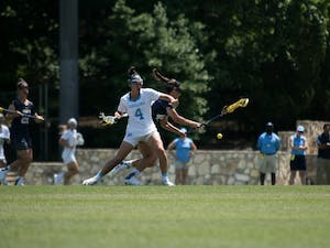 Marie McCool (4) defends a Navy player in North Carolina's final game of the 2017 season at Fetzer Field.