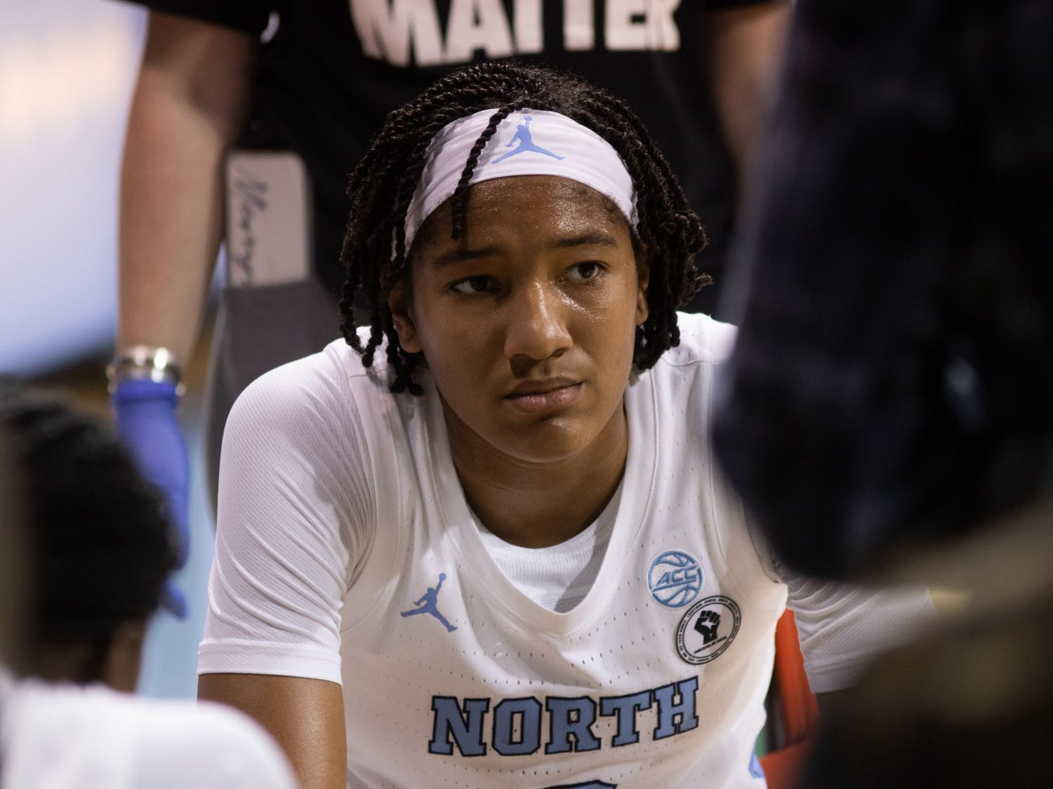 UNC first year guard Kennedy Todd-Williams listens to the coaches during a timeout during Carolina's 95-70 victory over High Point at Carmichael Arena, November 29, 2020.