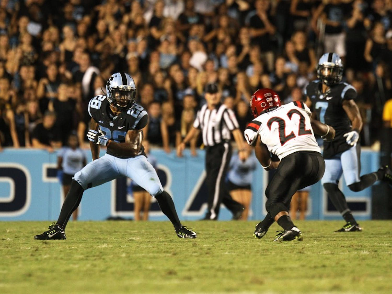 UNC cornerback Brian Walker (28) defends San Diego State's Kalan Montgomery (22).  Walker would go on to make the game saving interception late in the game.