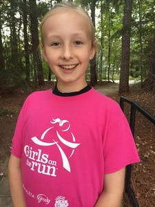 Elementary school student Elizabeth Boltz is one of three girls that were awarded the Carrie On Award from Girls on the Run..Photo courtesy of Julliellen Simpson-Vos.