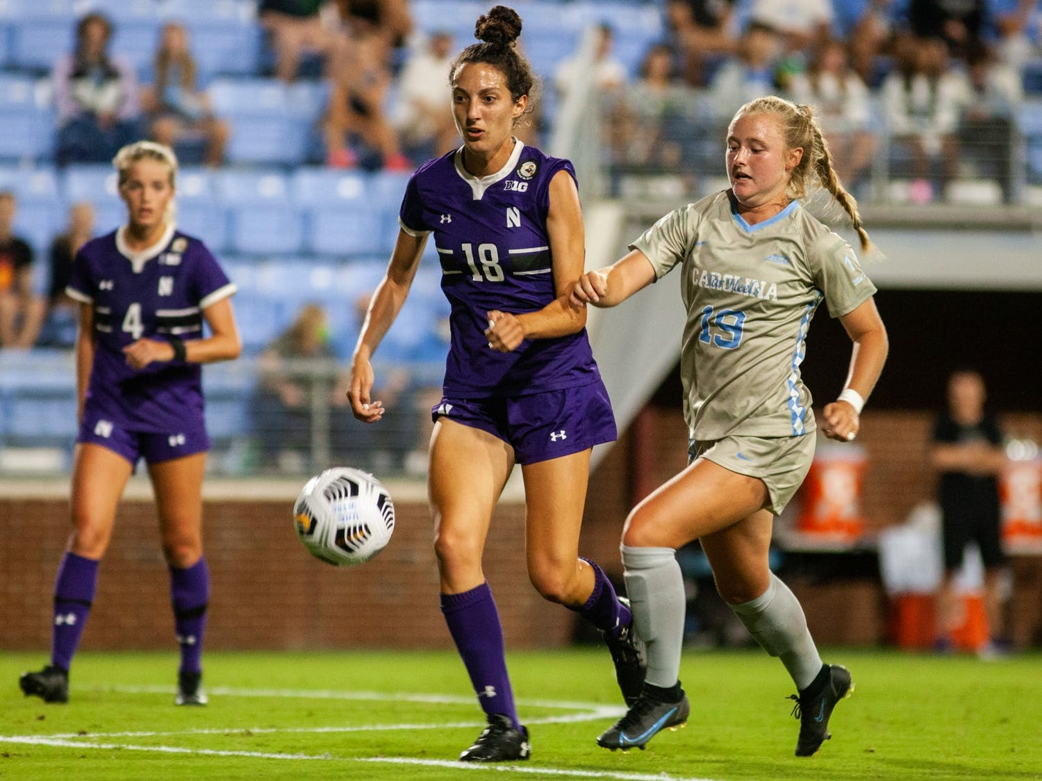 Freshman midfielder Emily Colton (19) fights for possession of the ball at the home game against Northwestern on Sept 2. UNC won 2-0.