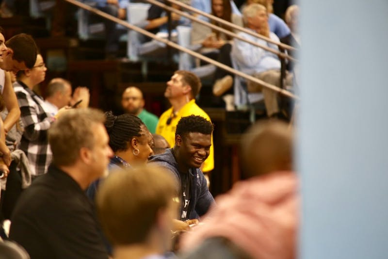 Five-star recruit Zion Williamson sits court side at North Carolina's exhibition game against Barton College on Oct. 19.