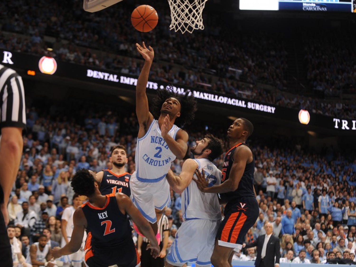 UNC first-year guard Coby White (2) shoots against Virgina on Monday, Feb. 11, 2019 in the Smith Center. White scored 17 points.