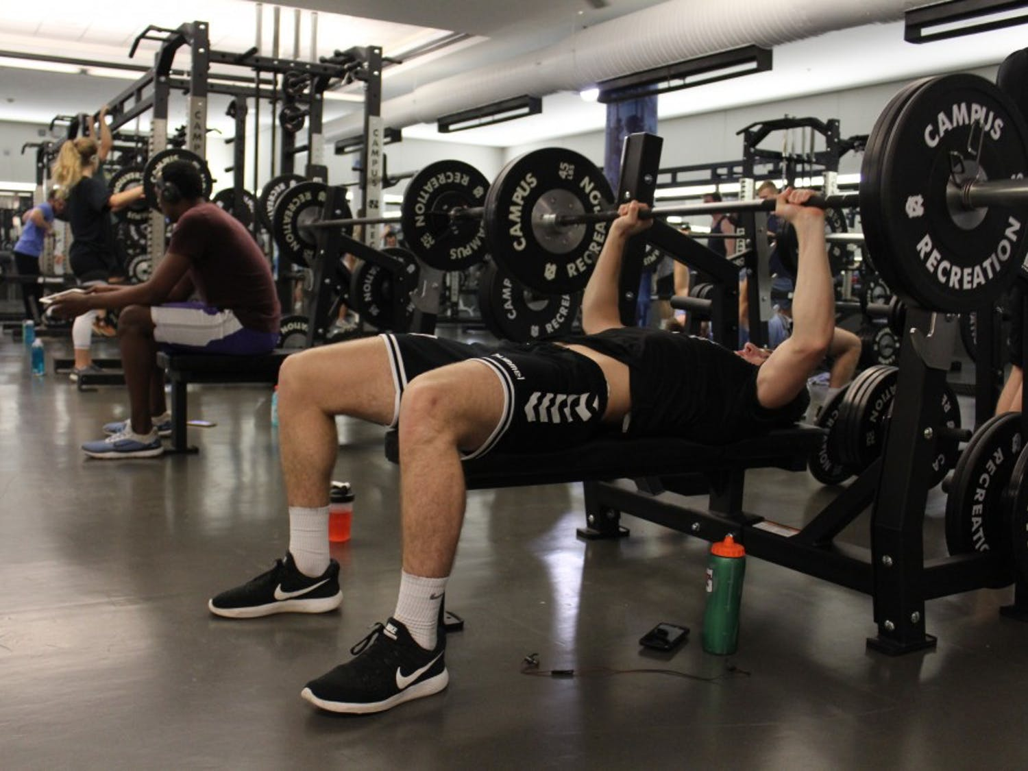 Sophomore chemistry major Aaron Hamm utilizes one of the new bench presses that are a part of the new additions during the ongoing renovations at the Student Recreation Center on Oct. 24, 2018.