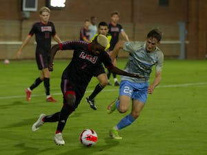 UNC senior midfielder Milo Garvanian (22) attempts to defend the ball during the match against Loyola Marymount on Oct. 19. The Tar Heels defeated the Lions 2-0.