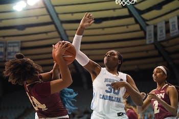UNC junior center Janelle Bailey (30) blocks Elon freshman forward Maya Johnson (24) on Friday, Nov. 23, 2019 in Carmichael Arena. UNC won 76-46.