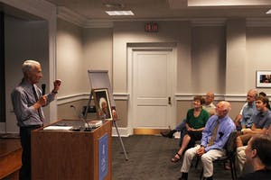 English professor George Lensing reads one of Seamus Heaney's poems at an event honoring the poet.
