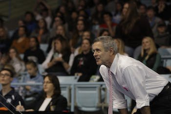 Gymnastics Head Coach Derek Galvin watches UNC compete against University of Oklahoma and Ball State University on Saturday, Jan. 19, 2019 in Carmichael Arena.