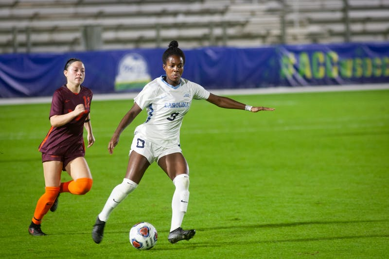 UNC junior midfielder Brianna Pinto (8) dribbles past Virginia Tech junior midfielder Grace Sklopin (11) during the first round of the ACC Tournament on Tuesday, Nov. 10, 2020 at the WakeMed Soccer Park. The Heels beat the Hokies 1-0.
