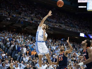 First-year guard Cole Anthony (2) attempts a basket against Virginia in the Smith Center on Saturday, Feb. 15, 2020.