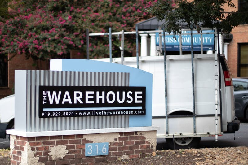 Warehouse Apartments on Rosemary Street is a popular off-campus housing location for UNC students. With classes moving online and on-campus housing de-densifying, questions are being raised around how clusters in off-campus housing will be communicated to the university community.