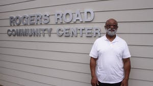 Rev. Campbell poses for a portrait in front of the Rogers Road Community Center.