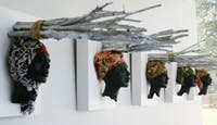 From October 20-December 17, 2011 the FedEx Global Education Center will host a sculptural exhibition of works by Mitch Lewis in order to bring greater awareness towards Darfur and American Activism. According to Lewis, the exhibition will