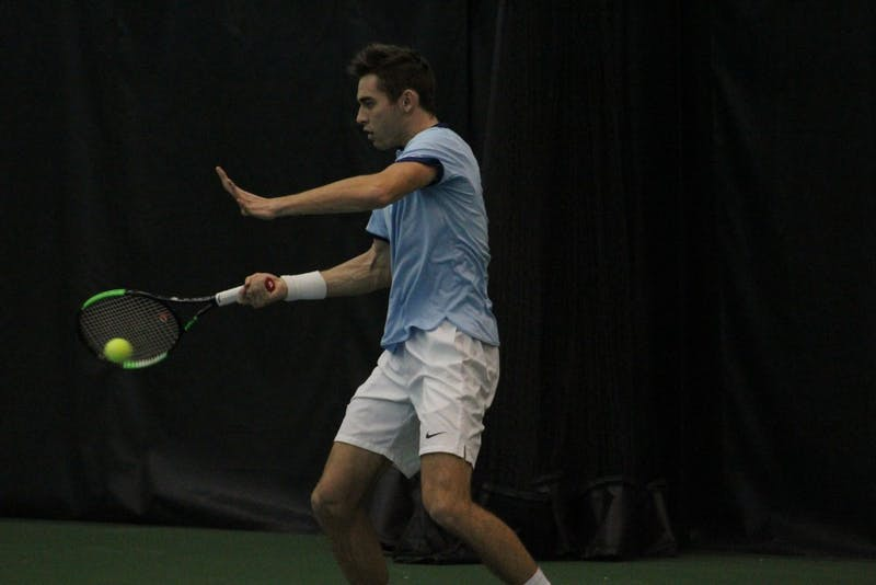 UNC's Benjamin Sigouin returns a shot against Texas Christian on Feb. 5 in the Cone-Kenfield Tennis Center.