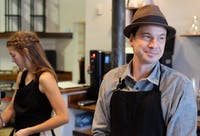 Shaw Sturton works alongside Laura Leech at Grey Squirrel, a new coffee show in Carrboro.