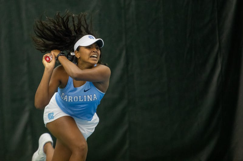 UNC first-year Anika Yarlagadda returns a volley during her singles match against the University of Michigan at the Cone-Kenfield Tennis Center in Chapel Hill, N.C., on Feb. 1, 2020. Yarlagadda went on to win her match giving the Tar Heels the last point needed to secure a 4-0 victory against Michigan.