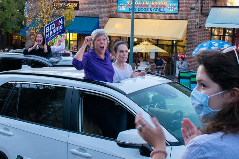 People in Chapel Hill celebrate former Vice President Joe Biden's projected win of the 2020 election on Saturday, Nov. 7, 2020.