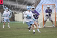 Attackman Andy Matthews looks to pass against Furman on Feb. 10 in Kenan Stadium.