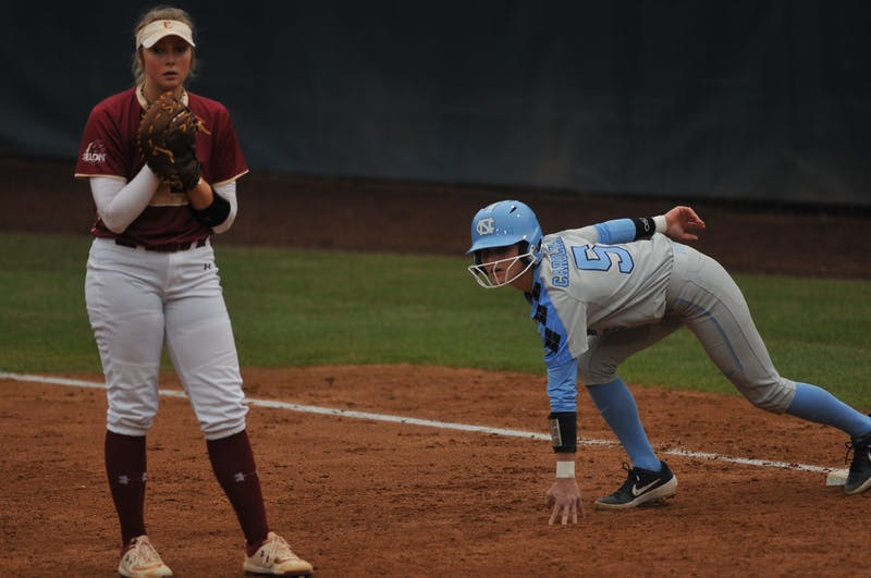 (From left) Elon first baseman Megan White (12) and UNC Campbell  Hutcherson waits for Elon's pitcher during a game against Elon on Wednesday, Feb. 26, 2020 in G. Anderson Softball Stadium. UNC lost to Elon 2-1.