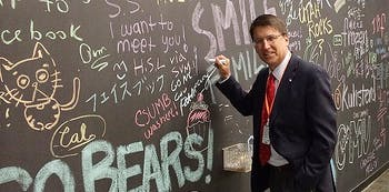 Governor Pat McCrory signs Facebook's wall at their headquarters in Menlo Park, Calif. on Monday during a visit focused on job creation. Courtesy of Ryan Tronovitch.