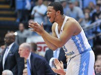 Senior Kennedy Meeks (3) cheers on the team from the sidelines.
