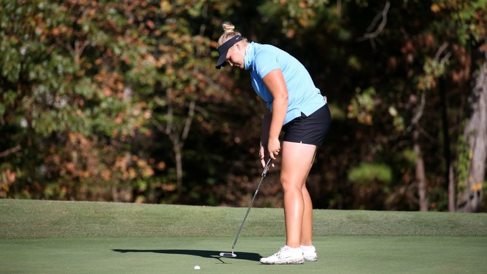 <p>Krista Junkkari prepares to put during the Ruth's Chris Tar Heel Invitational at Finley Golf Course on Friday, Oct. 11, 2019. Photo Courtesy of UNC Athletic Communications</p>