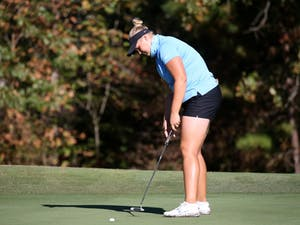 Krista Junkkari prepares to put during the Ruth's Chris Tar Heel Invitational at Finley Golf Course on Friday, Oct. 11, 2019. Photo Courtesy of UNC Athletic Communications