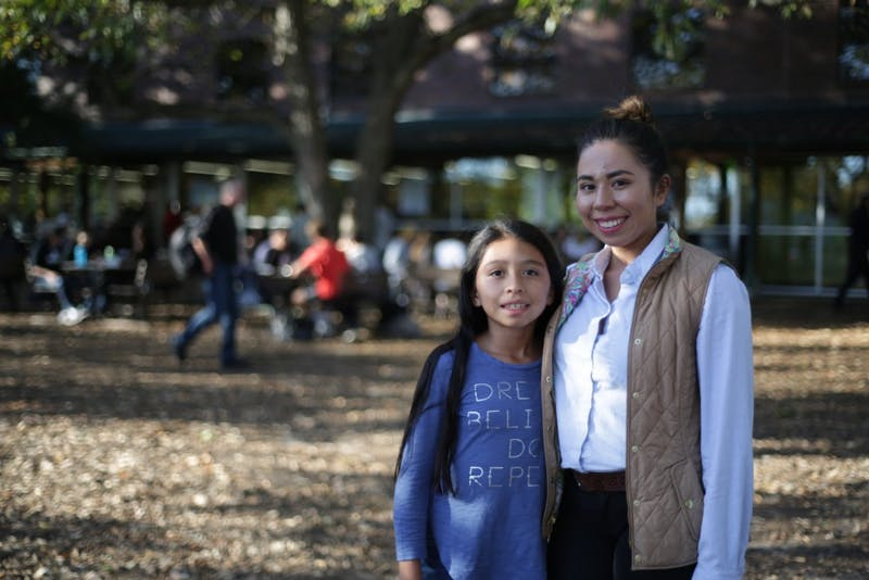 Johanna & Cynthia Salazar pose for a portrait outside of Weaver Street Market in Carrboro.