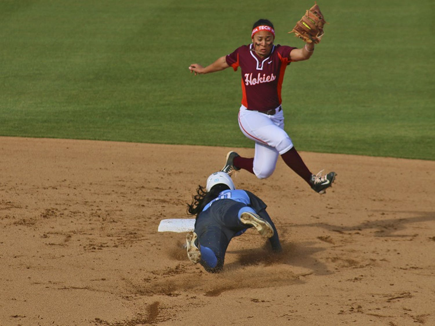 Junior outfielderAquilla Mateen (20)dives to a base during the Tar Heels' first game against the Hokies on Monday.