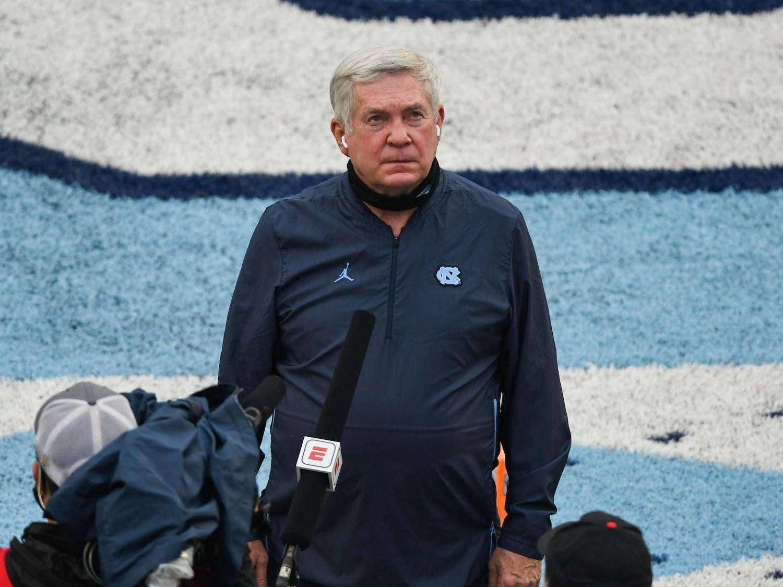 UNC football head coach Mack Brown is interviewed at Kenan Memorial Stadium before kickoff against Virginia Tech on Saturday, Oct. 10, 2020. UNC beat Virginia Tech 56-45.