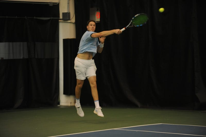 UNC tennis senior Blaine Boyden returns a serve during a match against Bucknell University on Saturday, Jan. 19, 2019.