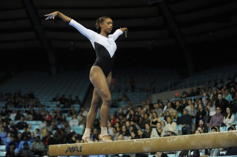 Junior Khazia Hislop competes on the beam during a meet against NC State in Carmichael Arena on Friday, Jan. 25, 2019.