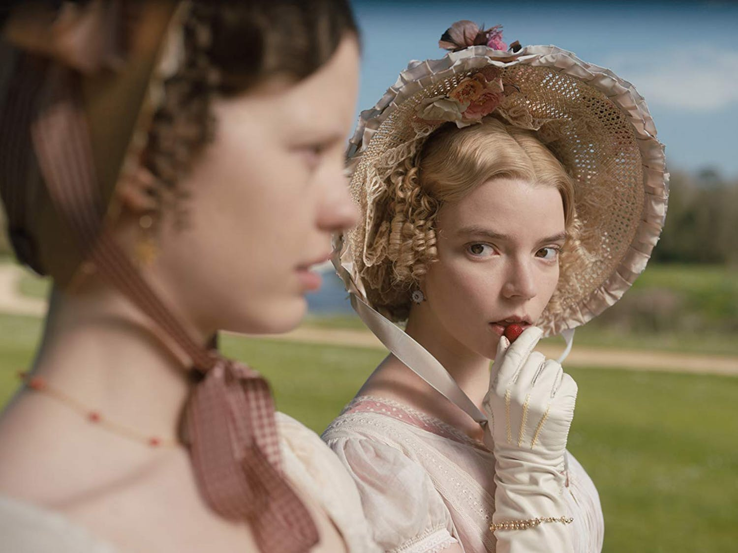"Anya Taylor-Joy, right, dons a joy-inducing bonnet in Autumn de Wilde's upcoming film ""Emma,"" based on the Jane Austen novel. Photo courtesy of Box Hill Films/Focus Features."
