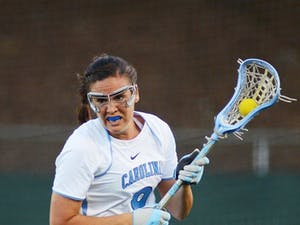 UNC midfielder Margaret Corzel (9) brings the ball out of the defensive zone after forcing a turnover.