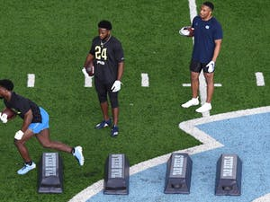 Michael Carter, Javonte Williams, Jordan Brown drill during University of North Carolina Football's Pro Day at the Indoor Practice Facility on Monday, March 29, 2021. Photo courtesy of Jeff Camarati.