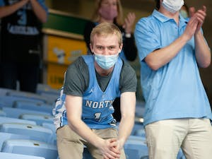 A fan celebrates a basket during UNC's 78-70 victory over Florida State in the Smith Center, Feb. 27, 2021. This was the first game this season for which fans were in attendance.