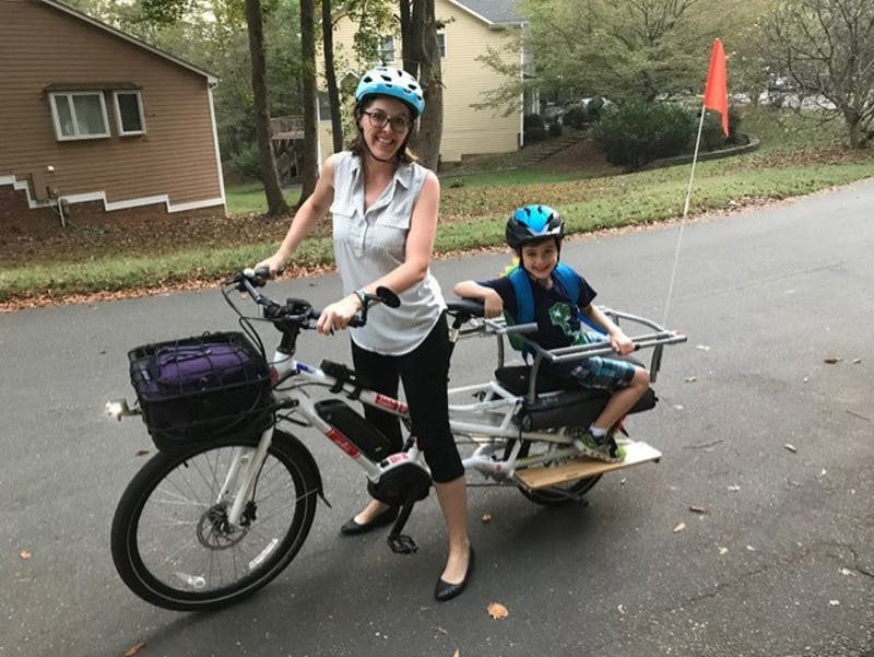 For Laura Sandt of Carrboro, cargo biking replaced more than just a few trips. She uses it to take her children to school and to go to work. Photo courtesy of Heidi Perov Perry.