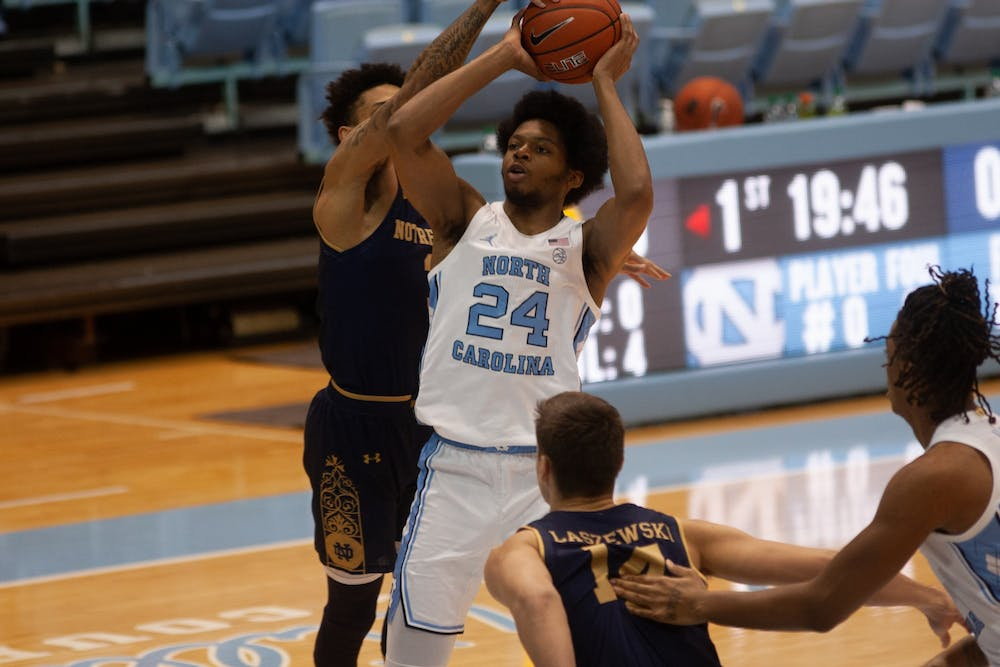 <p>UNC first year guard Kerwin Walton (24) aims for the basket during a game against Notre Dame in the Smith Center on Saturday, Jan. 2, 2021.&nbsp;</p>