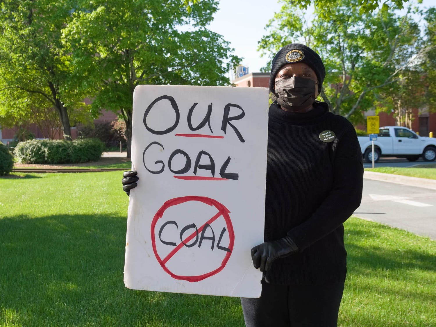 Anna Richards poses for a portrait outside of UNC's coal plant on Friday, Apr. 23, 2021.
