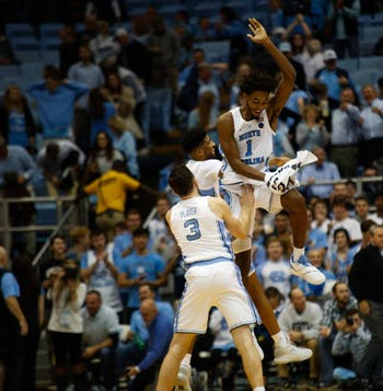 Sophomore guard Andrew Platek (3), freshman guard Leaky Black (1), and sophomore guard K.J. Smith (30) celebrate after beating Tennesee Tech 108-58 in the Dean Smith Center on Firday, Nov. 16, 2018.