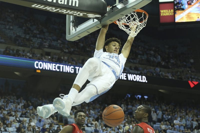 UNC forward Justin Jackson (44) dunks the ball against Radford on Sunday.