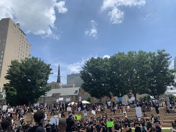 Protestors stand on the steps of Winston Square Park during a protest against police brutality on Saturday, June 6, 2020.