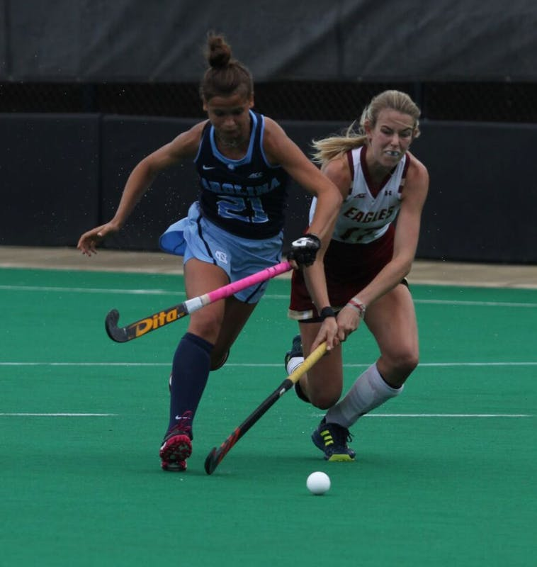 Midfielder Eva Smolenaars (21) fights for possession against Boston College on Saturday in Durham.